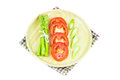 Close up Asparagus and slice tomato in wooden plate Royalty Free Stock Photo