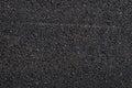 Close up of asphalt road,Black nature asphalt background,background texture of rough asphalt