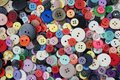 Colorful array of sewing buttons - background Royalty Free Stock Photo
