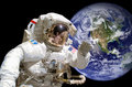 Close up of an astronaut in outer space, earth in the background Royalty Free Stock Photo