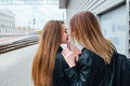 Close up of attractive young couple whispering to ear a secret and smiling. Happy relationship concept Royalty Free Stock Photo