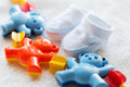 Close up of baby rattle and bootees for newborn Royalty Free Stock Photo