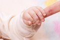 Close-up of baby's hand holding mother's finger Royalty Free Stock Images