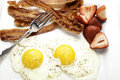 Close up of bacon and eggs view breakfast with fresh strawberries Royalty Free Stock Photo
