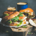Close-up of bagel with salmon, cream-cheese, vebegables and coffee espresso Royalty Free Stock Photo