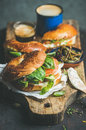 Close-up of bagels, espresso coffee and capers on wooden board Royalty Free Stock Photo