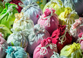 Close up bags of lavender in gift pouches multi colored embroidered cloth sacks tied with string Stock Image