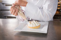 Close up of baker preparing handmade cake Royalty Free Stock Photo
