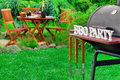 Close-up Of Barbecue Grill With Tools And BBQ Party Sign Royalty Free Stock Photo