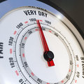 Close up barometer dial needle set to very dry concept global warming climate change Royalty Free Stock Photos