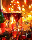 Close-up of bauble,candle and red wine. Stock Image