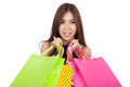 Close up of beautiful asian woman with colorful shopping bags isolated on white background Stock Photography