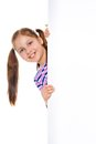 Close up beautiful girl pony tails hiding behind white placard Stock Photo