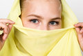 Close-up beautiful mysterious eyes eastern woman wearing a yellow hijab Royalty Free Stock Photo