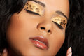 Close up on beautiful tiger make up eyes goldish blakish eyeshadow Royalty Free Stock Photos