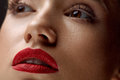 Close-up Of Beauty Woman Face With Beautiful Makeup And Red Lips Royalty Free Stock Photo