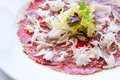 Close up Beef carpaccio with parmesan cheese. Royalty Free Stock Photos