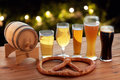Close up of beer glasses, barrel and pretzel Royalty Free Stock Photo