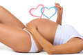 Close-up belly of pregnant woman. Gender: boy, girl or twins? Two Hearts Royalty Free Stock Photo