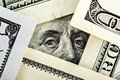 Close up of benjamin franklin portrait on the hundred dollar bill framed by other banknotes Stock Photos