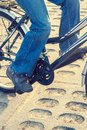 Close up of bike rider legs retro toned Royalty Free Stock Photography