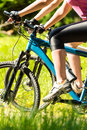Close up of bikers legs on bikes mountain wearing cycling shoes Stock Photography