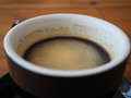 Close up black coffee in cup. focus on bubble Royalty Free Stock Photo