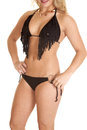 Close up black fringe a woman in her bikini with a smile on her face Stock Photos