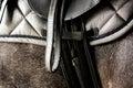 Close up of black leather saddle on horse back Royalty Free Stock Photo