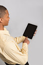 Close up of Black Man Hand Pointing to Tablet PC Stock Photography