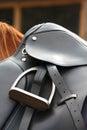 Close up of black saddle on horse back Royalty Free Stock Photo
