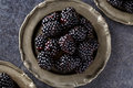 Close up blackberries in plate on dark table background Royalty Free Stock Photo