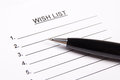 Close up of blank wish list and pen metal Stock Photography