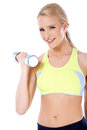 Close up of blond happy woman with dumbbell in her hand over white background Royalty Free Stock Image