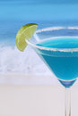 Close up blue curacao cocktail on the beach while vacation Royalty Free Stock Photos