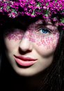 Close up of blue-eyed woman with flowers Stock Photos