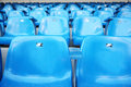 Close up of blue grandstand for fans with numbers at football stadium Stock Photography