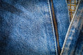 Close up of blue jeans fabric with seam and zipper Royalty Free Stock Photo