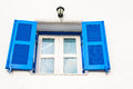 Close up blue window on white wall background Royalty Free Stock Photo