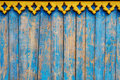 Close up of blue wooden fence panels with yellow bordering shabby background planks Royalty Free Stock Images