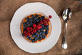 Close-up of blueberry tart on rustic table Royalty Free Stock Photo