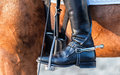 Close up of a boot rider with spurs wheel Royalty Free Stock Image