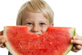 Close up of boy holding out water melon a cute happy a big juicy slice watermelon isolated on white Stock Photography