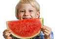 Close up of boy smiling behind water melon shot a cute happy a juicy slice watermelon isolated on white Stock Photo