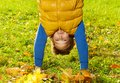 Close up of a boy stand on hands years old standing outside sunny day balancing Royalty Free Stock Photography