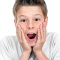 Close up of boy with surprising face expression. Royalty Free Stock Photo