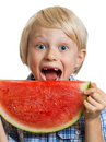 Close up of boy taking bite of water melon a cute happy smiling about to take a juicy slice watermelon isolated on white Royalty Free Stock Photography