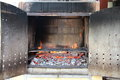 Close up on brick barbecue with flames ready to be used Royalty Free Stock Photo