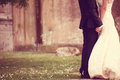 Close up of a bride and groom holding hands Royalty Free Stock Photo