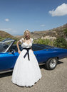 Close up of Bride next to wedding car Royalty Free Stock Photo